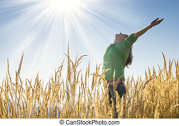 Happy in the grass - Happy young girl raising her arms with ...