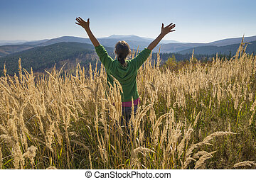 Happy in the mountains - Happy young girl enjoying the ...