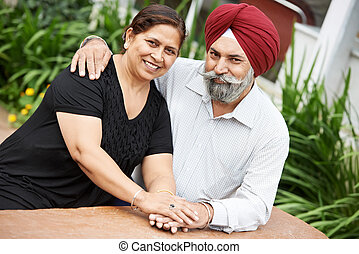 Happy indian adult people couple - Happy Smiling indian sikh...