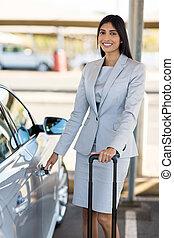 indian businesswoman opens car door