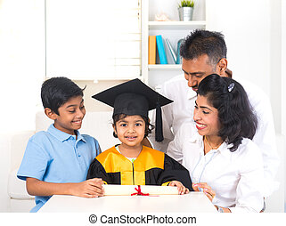 Happy indian family graduation, education concept photo