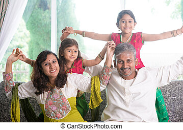 Happy Indian family playing at home