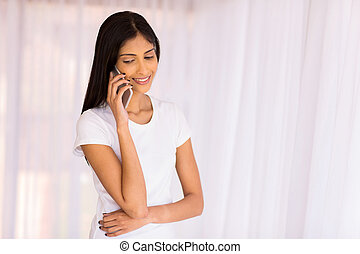 indian girl talking on mobile phone