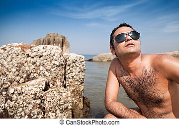 Happy indian man with sunglasses
