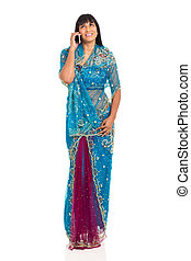indian woman talking on her mobile phone