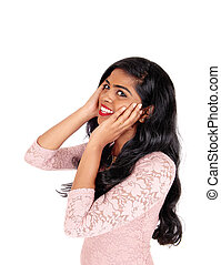 Happy Indian woman with long hair.