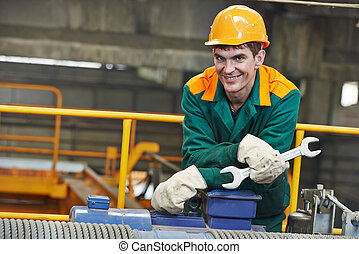 Happy industry worker repairman with spanner - smiling...