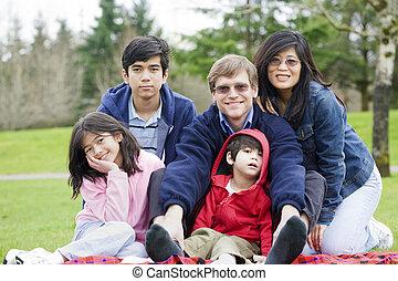 Happy interracial family enjoying a day at the park