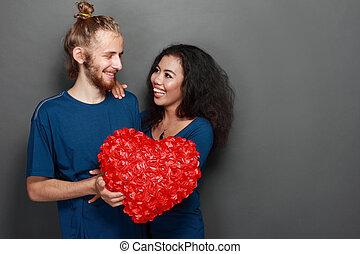 happy interracial young couple