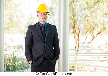 Happy investor wearing a helmet