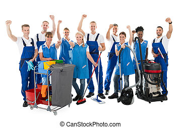 Happy Janitors With Arms Raised Holding Cleaning Equipment -...
