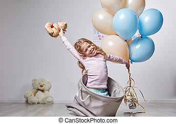Happy joyful kid has fun in nursery