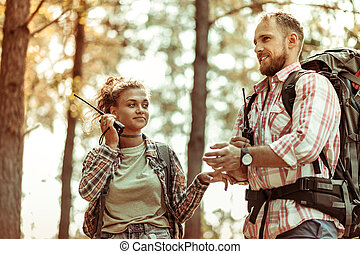 Happy joyful man hiking with his girlfriend