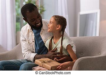 Happy joyful man sitting with his daughter