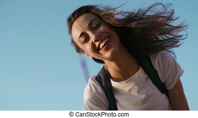 happy joyful smiling young pretty woman in white t-shirt is...
