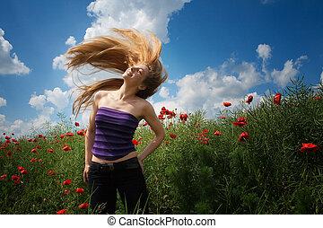 Happy joyful woman in beautiful poppy field
