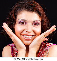 Happy joyful woman with hands at face