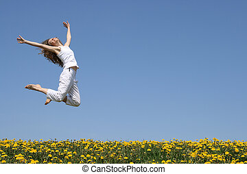 Beautiful smiling young woman in a happy jump.