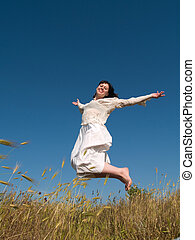 Happy Jumping Girl on Field