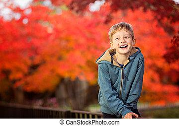 happy kid at fall