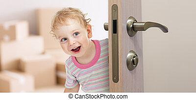 happy kid behind door in new room - happy kid behind his new...