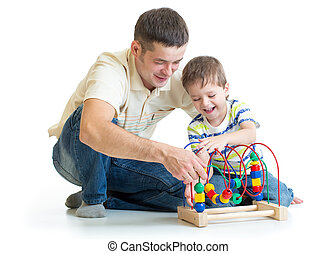 happy kid boy and dad playing toy