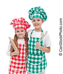 Happy kid chefs with wooden cooking utensils
