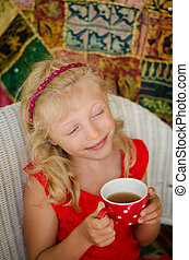 happy kid drinking tea