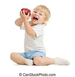 Happy kid eating apple