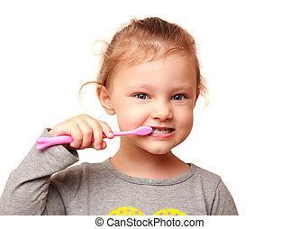 Happy kid girl brushing white teeth isolated