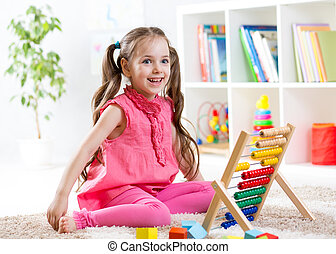 kid girl playing with abacus