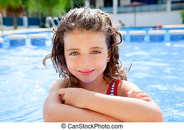 happy kid girl smiling at swimming pool