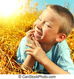 Happy Kid - Happy Young Boy in the Wheat Field