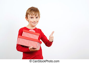 Happy little boy with presents isolated over white background. Cute boy with present box.