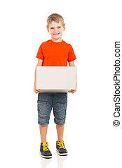 kid holding laptop