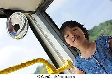Happy kid in bus