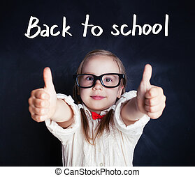 Happy kid in glasses with thumb up. Back to school.
