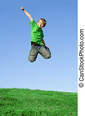 happy kid jumping outside in summer