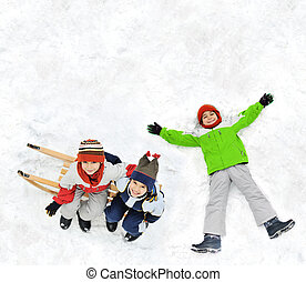 Happy kid on snow - Happy kid lies on snow ground