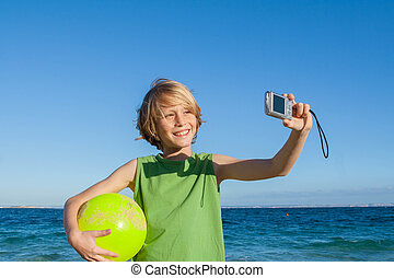 happy kid on summer holiday taking selfie photo