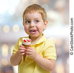 Happy kid or child eating icecream