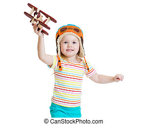 happy kid pilot and playing with wooden airplane toy