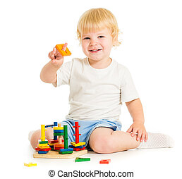 happy kid playing education toys