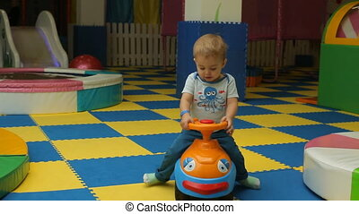 Happy kid playing in playground,toy car