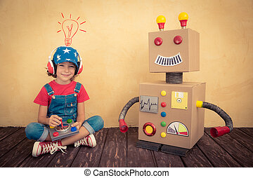 Happy kid playing with toy robot