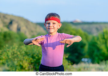 Happy Kid Practicing Martial Arts Moves Outdoor