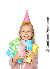 Happy kid receiving present on boxing day. Little girl smiling with wrapped present boxes. Small child in pink hat holding birthday gifts isolated on white background. Holiday, celebration concept