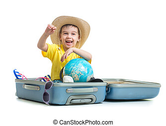 Happy kid sitting in suitcase prepared for vacation