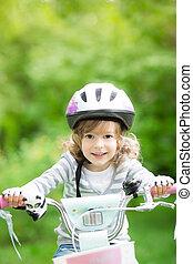 Happy kid sitting on the bike