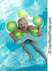 happy kid swimming